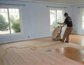 Man Sanding Wood Floors